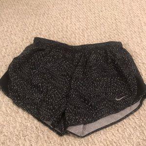 black and gray patterning Nike running shorts